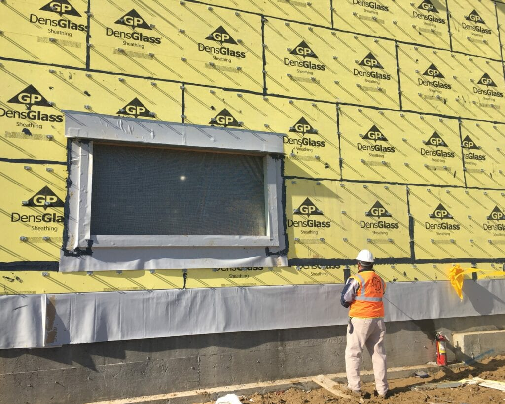 chm employee looking over air barrier installation