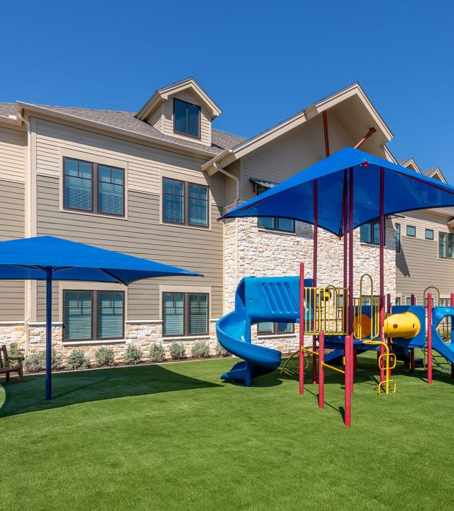 Dallas Ronald McDonald House building with outdoor playground